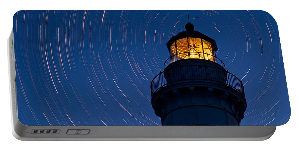Astronomy Portable Battery Charger featuring the photograph Cana Island Lighthouse Solstice by Steve Gadomski