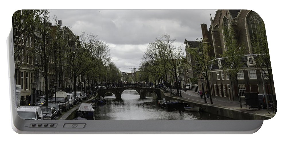 2014 Portable Battery Charger featuring the photograph Canal Behind Oude Kerk In Amsterdam by Teresa Mucha