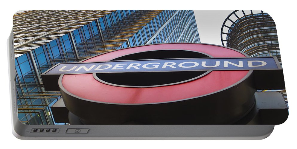 Tube Portable Battery Charger featuring the photograph Canary Wharf Tube Sign by David Pyatt