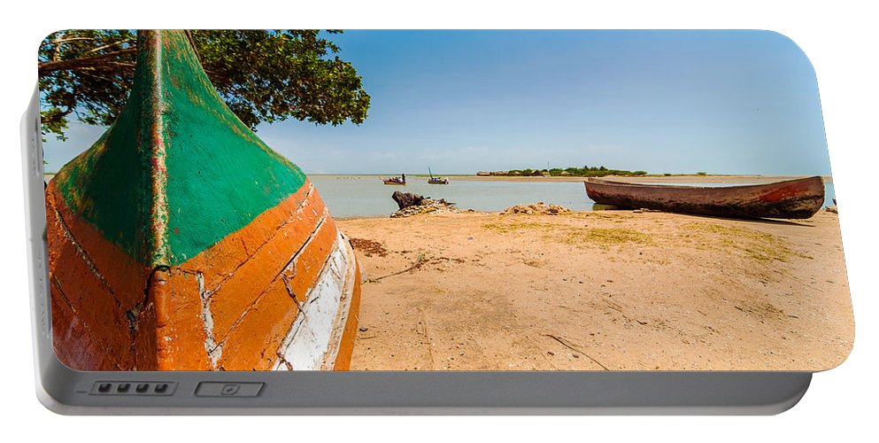 Water Portable Battery Charger featuring the photograph Canoes On A Lakeshore by Jess Kraft