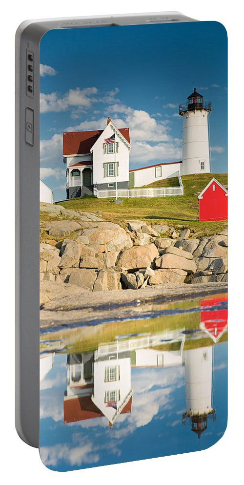 Light Portable Battery Charger featuring the photograph Cape Neddick Light Reflections by Emmanuel Panagiotakis
