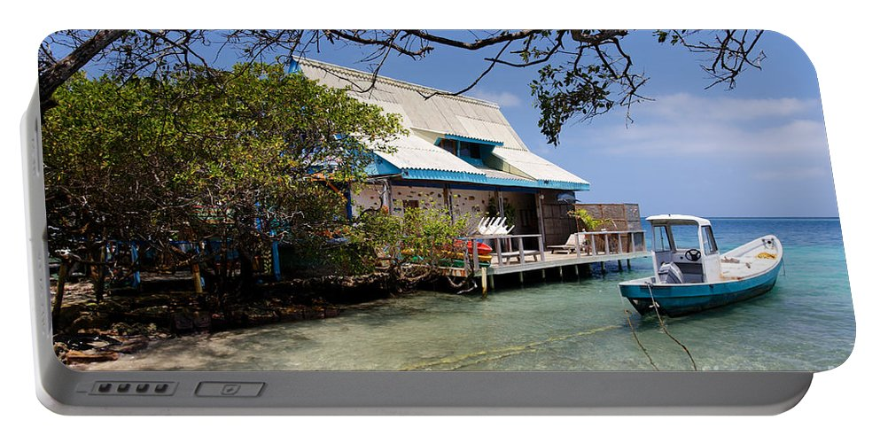 Adrift Portable Battery Charger featuring the photograph Caribbean House And Boat by Jannis Werner