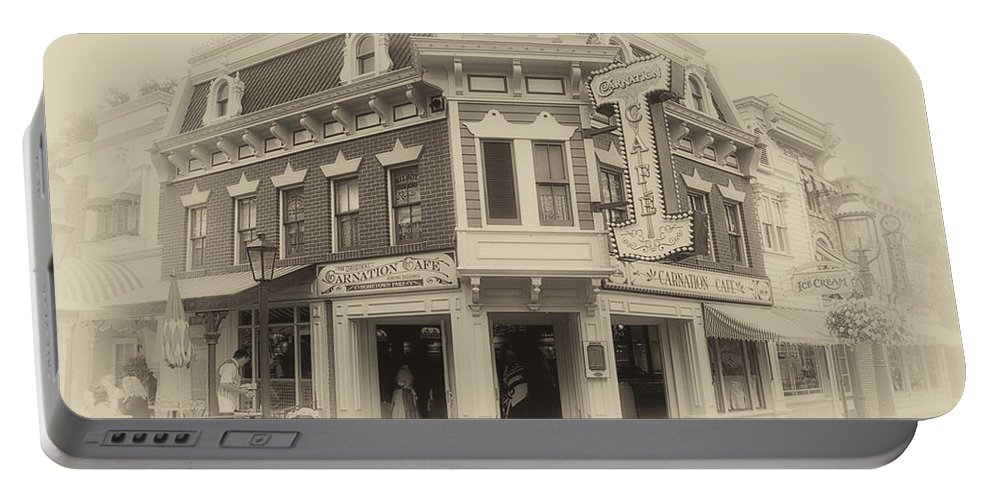 Disney Portable Battery Charger featuring the photograph Carnation Cafe Main Street Disneyland Heirloom by Thomas Woolworth
