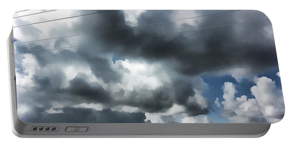 Digital Portable Battery Charger featuring the photograph Carolina Clouds by Paulette B Wright