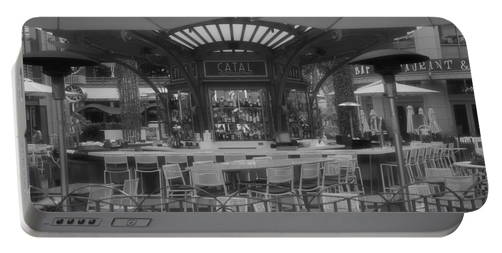 Disney Portable Battery Charger featuring the photograph Catal Outdoor Cafe Downtown Disneyland Bw by Thomas Woolworth