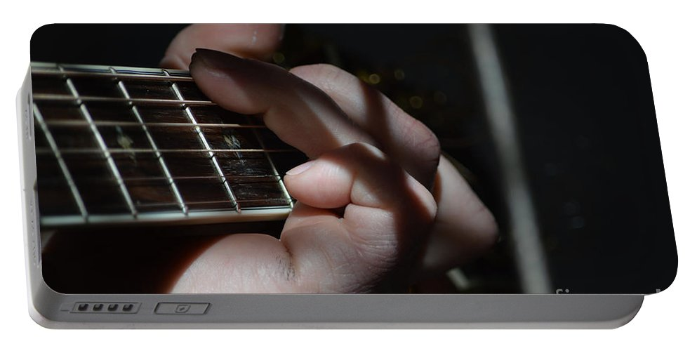 Musician Portable Battery Charger featuring the photograph Catching The Light by Alys Caviness-Gober