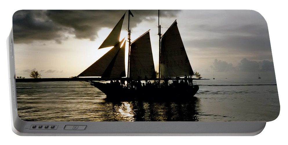 Key West Portable Battery Charger featuring the photograph Celebrating Sunset Photograph by Kimberly Walker