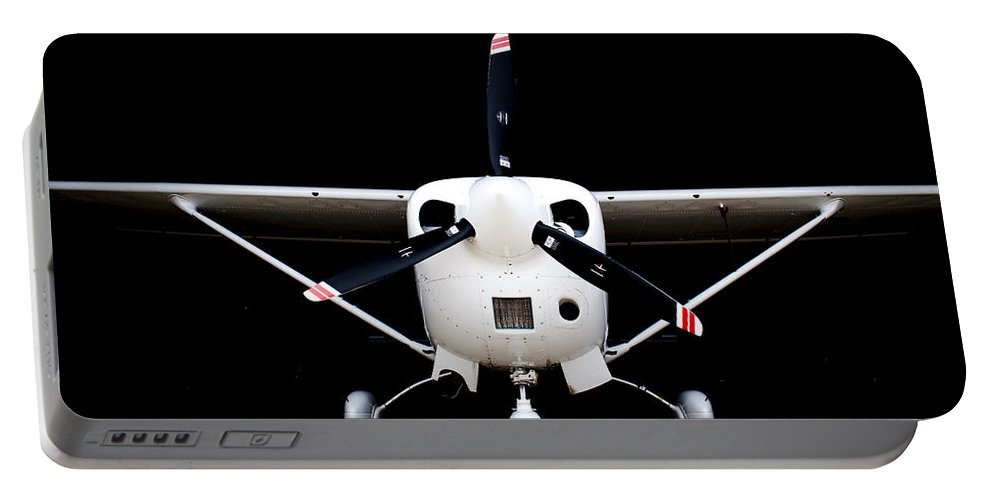 Cessna Portable Battery Charger featuring the photograph Cessna Dark Hanger by Paul Job