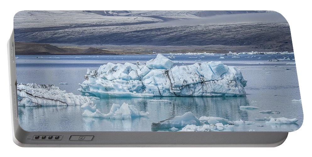 Jokulsarlon Portable Battery Charger featuring the photograph Chasing Ice by Evelina Kremsdorf