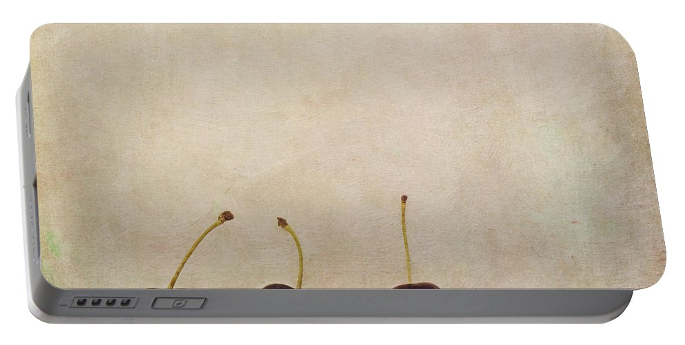 Minimalist Still Life Image With Three Cherries On A Board. Portable Battery Charger featuring the photograph Cherries by Priska Wettstein