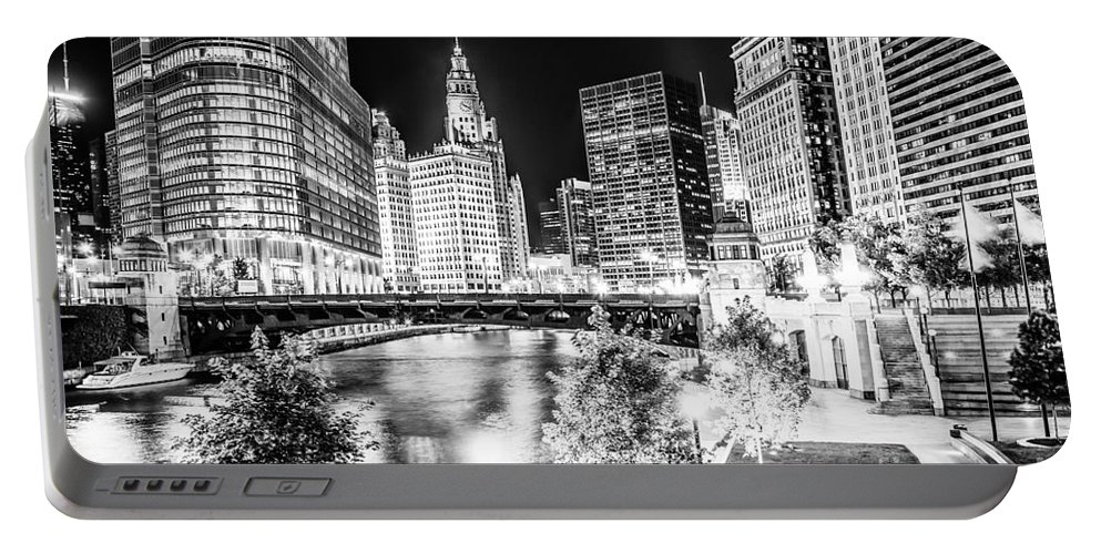America Portable Battery Charger featuring the photograph Chicago River Buildings at Night in Black and White by Paul Velgos