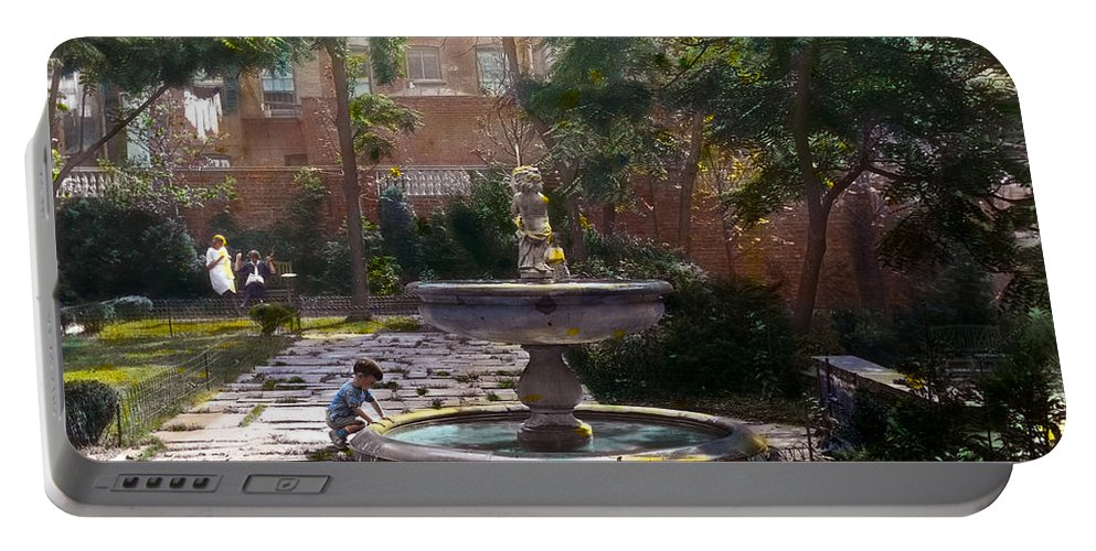 Tranquil Portable Battery Charger featuring the photograph Child And Fountain by Terry Reynoldson