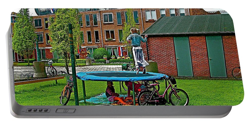 Children At Play In Enkhuizen Portable Battery Charger featuring the photograph Children At Play In Enkhuizen-netherlands by Ruth Hager