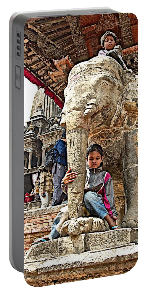 Children Love The Elephants In Patan Durbar Square In Lalitpur In Nepal Portable Battery Charger featuring the photograph Children Love The Elephants In Patan Durbar Square In Lalitpur-nepal by Ruth Hager