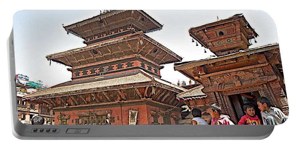 Children On Pagodas In Bhaktapur Durbar Square In Bhaktapur In Nepal Portable Battery Charger featuring the photograph Children On Pagodas In Bhaktapur Durbar Square In Bhaktapur-nepal by Ruth Hager