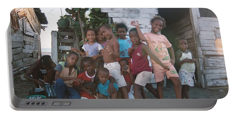 Girl Portable Battery Charger featuring the photograph Cildren Of The Coast by David Cardona