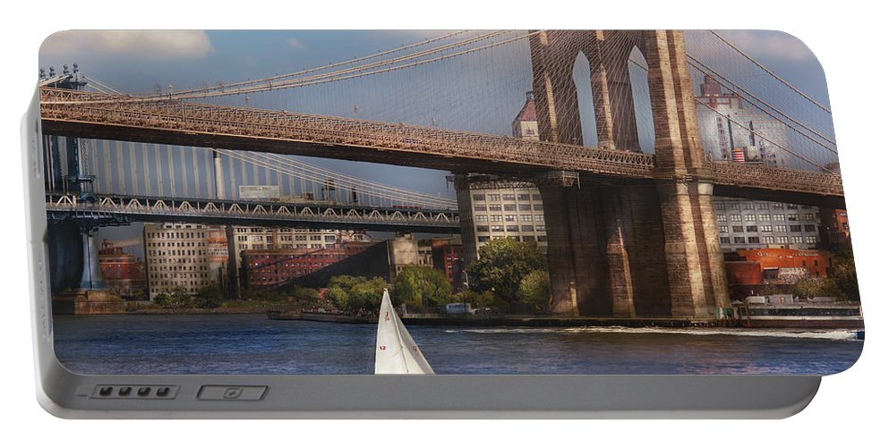 Savad Portable Battery Charger featuring the photograph City - Ny - Sailing Under The Brooklyn Bridge by Mike Savad