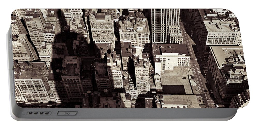 New York Portable Battery Charger featuring the photograph City Shadow by Dave Bowman