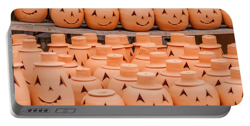 Clay Portable Battery Charger featuring the photograph Clay Pumpkins Standing Happy Near The Wood Fence by Alex Grichenko
