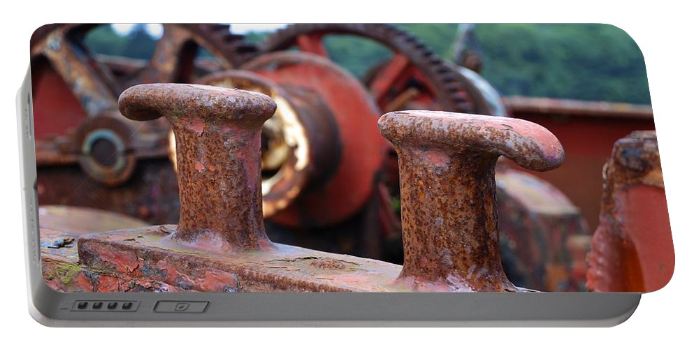 Rust Portable Battery Charger featuring the photograph Cleat by Charlie and Norma Brock