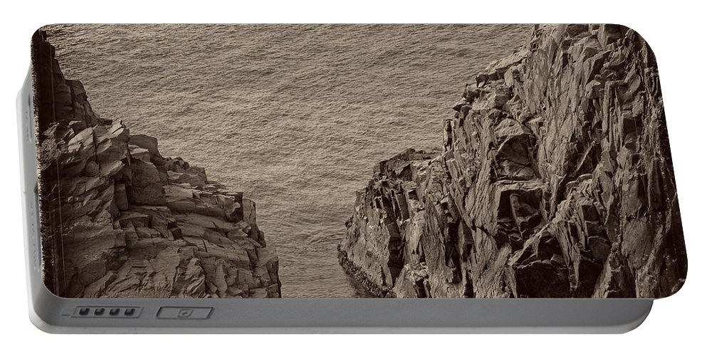 Cliffs Portable Battery Charger featuring the photograph Cliffs At Bonavista by David Stone