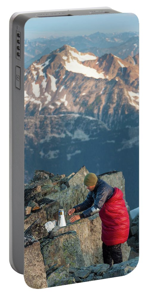 People Portable Battery Charger featuring the photograph Climber Lights His Ultralight Stove by Christopher Kimmel