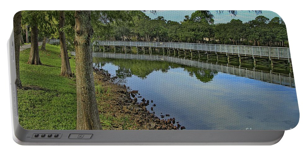 Park Portable Battery Charger featuring the photograph Cloud Reflection At The Pond by Deborah Benoit