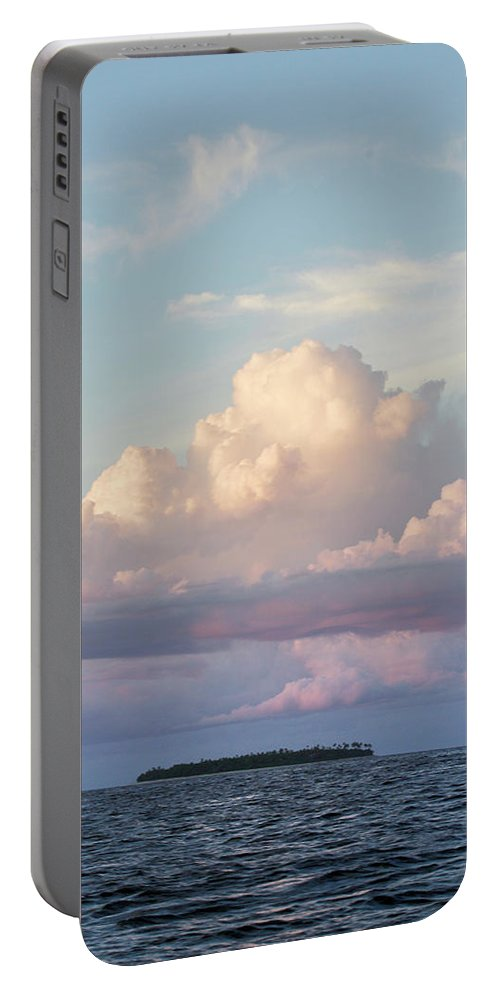 Cloud Portable Battery Charger featuring the photograph Clouds Glow In The Sky During Sunset by Eyeconic Images