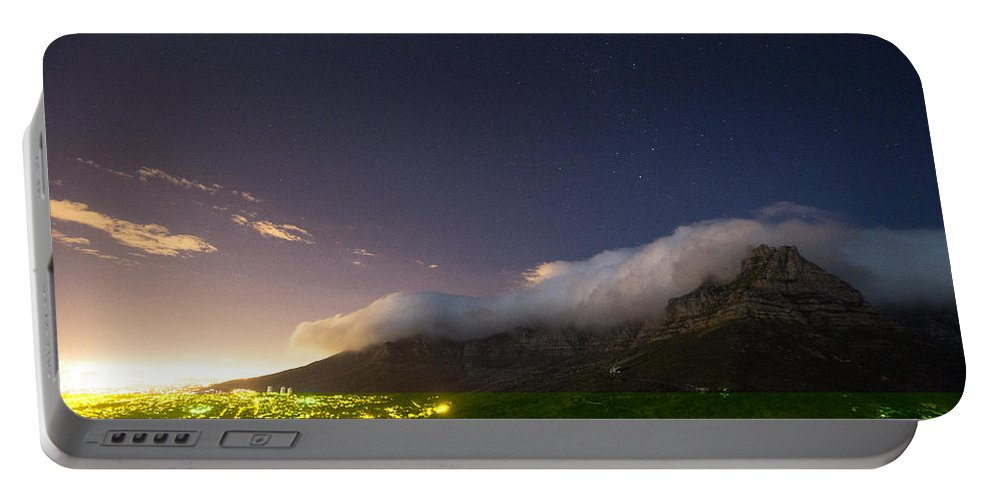 Illuminated Portable Battery Charger featuring the photograph Clouds Loom Over Table Mountain In Cape by Matt Andrew