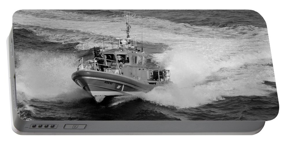 Harbor Portable Battery Charger featuring the photograph Coast Gaurd In Action In Black And White by Rob Hans