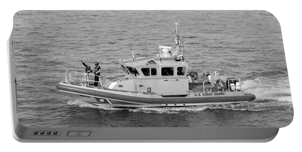 Harbor Portable Battery Charger featuring the photograph Coast Guard On Patrol In Black And White by Rob Hans