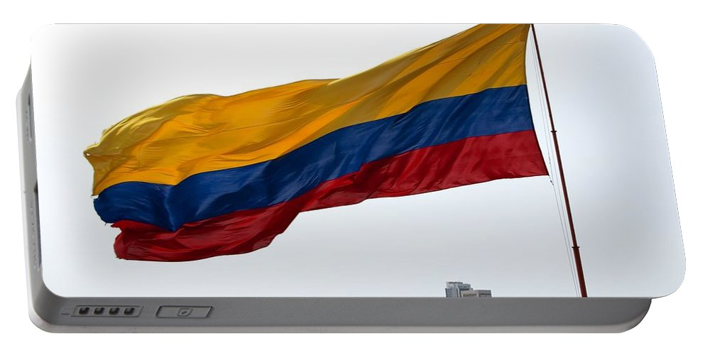 Barajas Portable Battery Charger featuring the photograph Colombian Flag Over Cartagena by Jannis Werner
