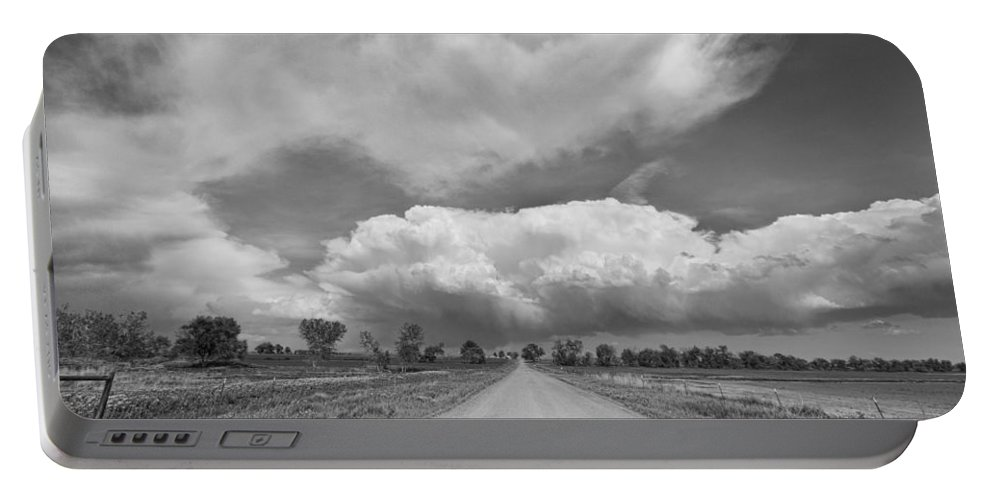 Road Portable Battery Charger featuring the photograph Colorado Country Road Stormin Skies Bw by James BO Insogna