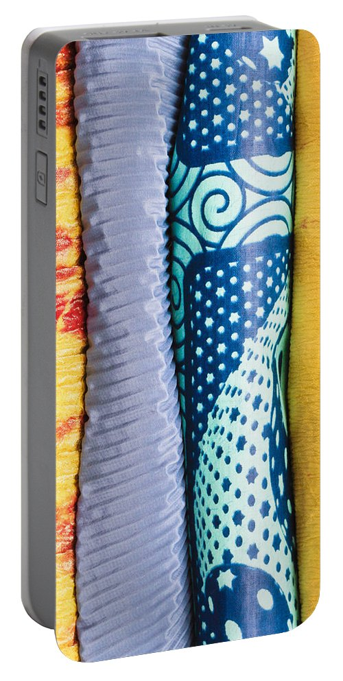 Africa Portable Battery Charger featuring the photograph Colorful Fabrics by Tom Gowanlock