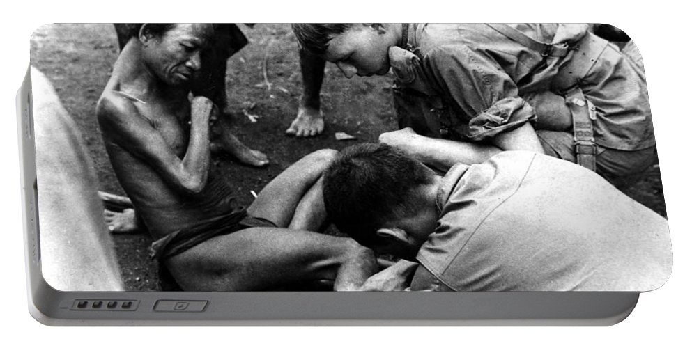 Montagnard Portable Battery Charger featuring the photograph Compassion by Norman Johnson