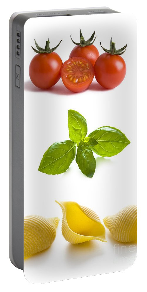 Cherry Portable Battery Charger featuring the photograph Conchiglioni Pasta Shells Tomatoes And Basil Leaves by Lee Avison