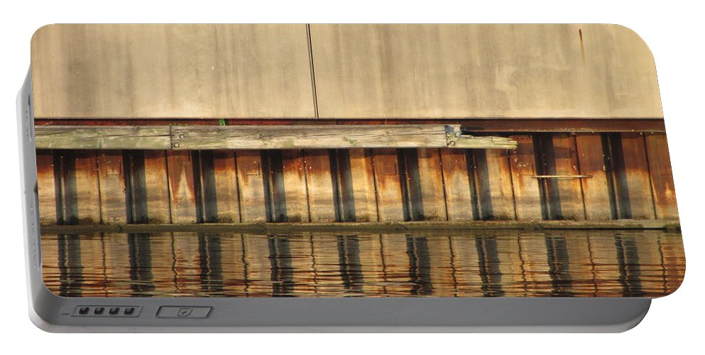 Milwaukee Portable Battery Charger featuring the photograph Concrete Wall And Water 1 by Anita Burgermeister