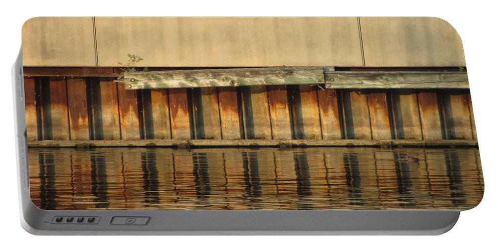 Milwaukee Portable Battery Charger featuring the photograph Concrete Wall And Water 2 by Anita Burgermeister