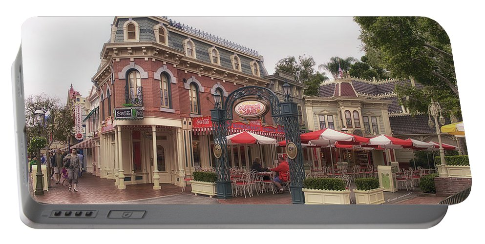 Disney Portable Battery Charger featuring the photograph Corner Cafe Main Street Disneyland 02 by Thomas Woolworth