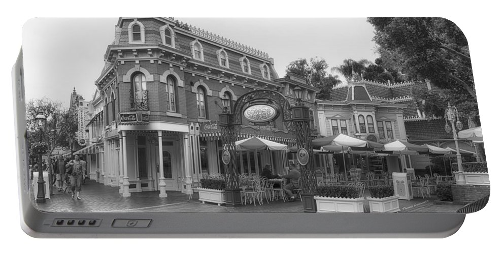 Disney Portable Battery Charger featuring the photograph Corner Cafe Main Street Disneyland Bw by Thomas Woolworth