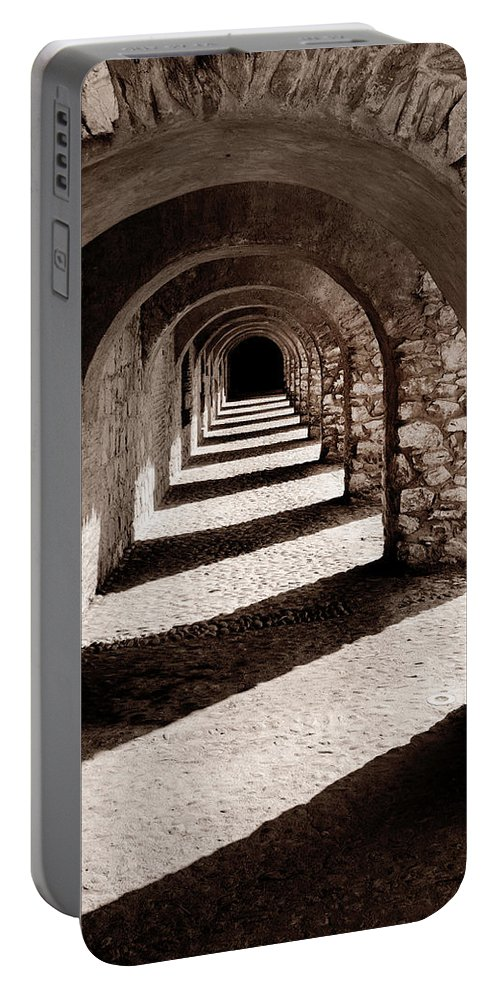 Arch Portable Battery Charger featuring the photograph Corridors Of Stone by Dave Hare