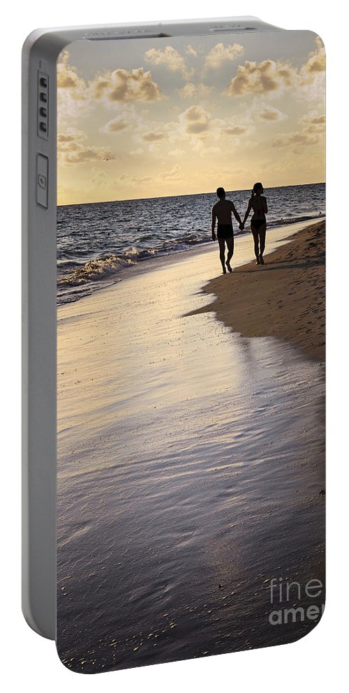 Couple Portable Battery Charger featuring the photograph Couple Walking On A Beach by Elena Elisseeva
