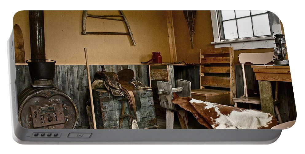 Cabin Portable Battery Charger featuring the photograph Cowboy Corner by Linda Bianic