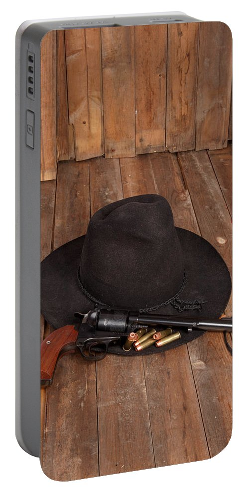 Cowboy Hat Portable Battery Charger featuring the photograph Cowboy Hat And Gun by Scott Sanders