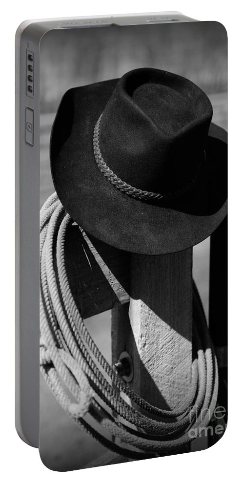 Paul Ward Portable Battery Charger featuring the photograph Cowboy Hat On Fence Post In Black And White by Paul Ward
