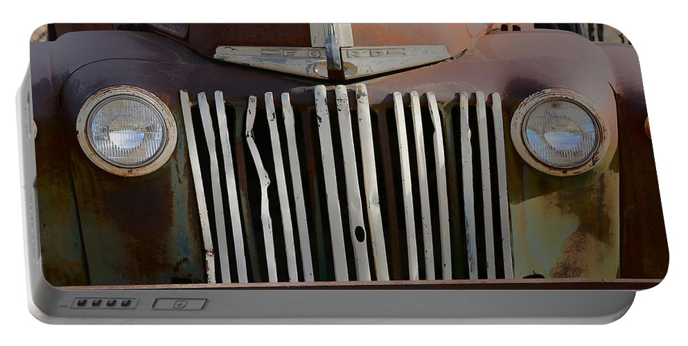 Rust Portable Battery Charger featuring the photograph Crooked Grill by Lynn Sprowl