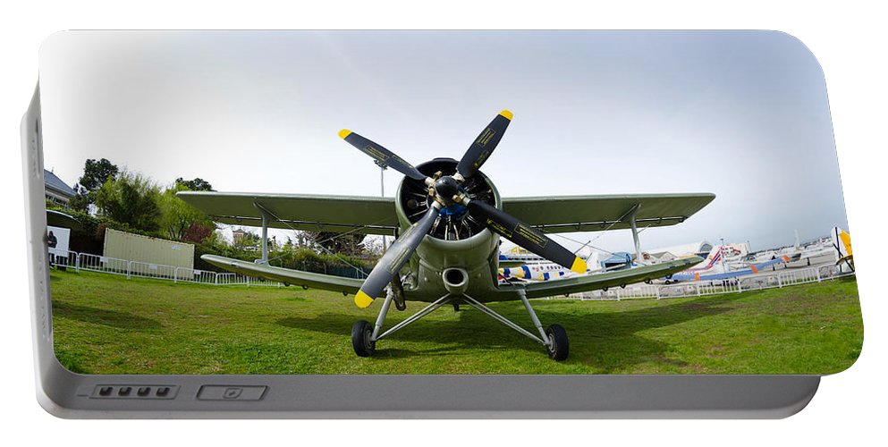 Cuatro Portable Battery Charger featuring the photograph Polikarpov Po-2 by Pablo Lopez