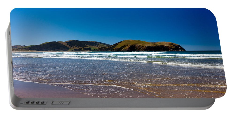 South Island Portable Battery Charger featuring the photograph Curio Bay On South Coast Of New Zealand South Island by Stephan Pietzko