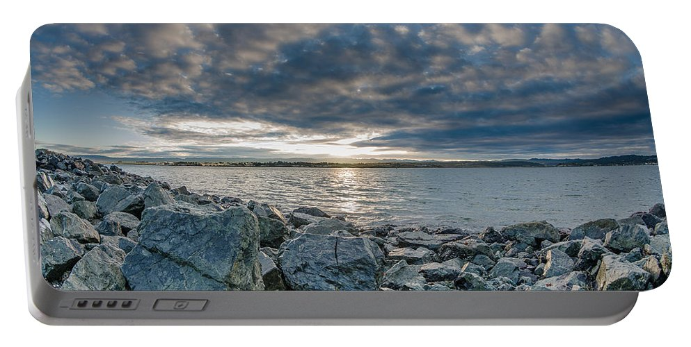 Sunrise Portable Battery Charger featuring the photograph Curve Off The Bay by Greg Nyquist