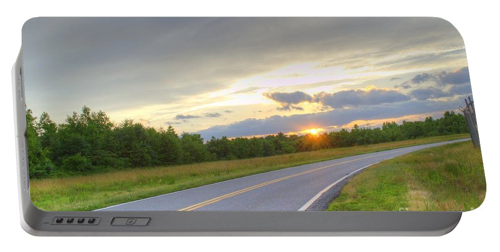 A Curvy Road With A Nice Sunset. Bob Wire Fence Trees Clouds Sun Sky Summer Nice Day Beautiful Day  Portable Battery Charger featuring the photograph Curvy Road Sunset by Robert Loe